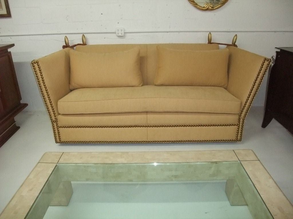 Hight back and sides sofa. Completelyre-upholstered in a soft yellow Thick linen. Interesting and great look from each side (back and sides.) Very comfortable and elegant. Easy to match with any style.