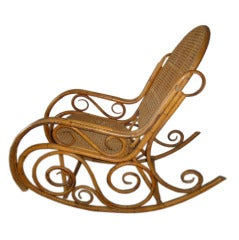 Mid Century  Elegant Rattan Rocking Chair in the Thonet Style