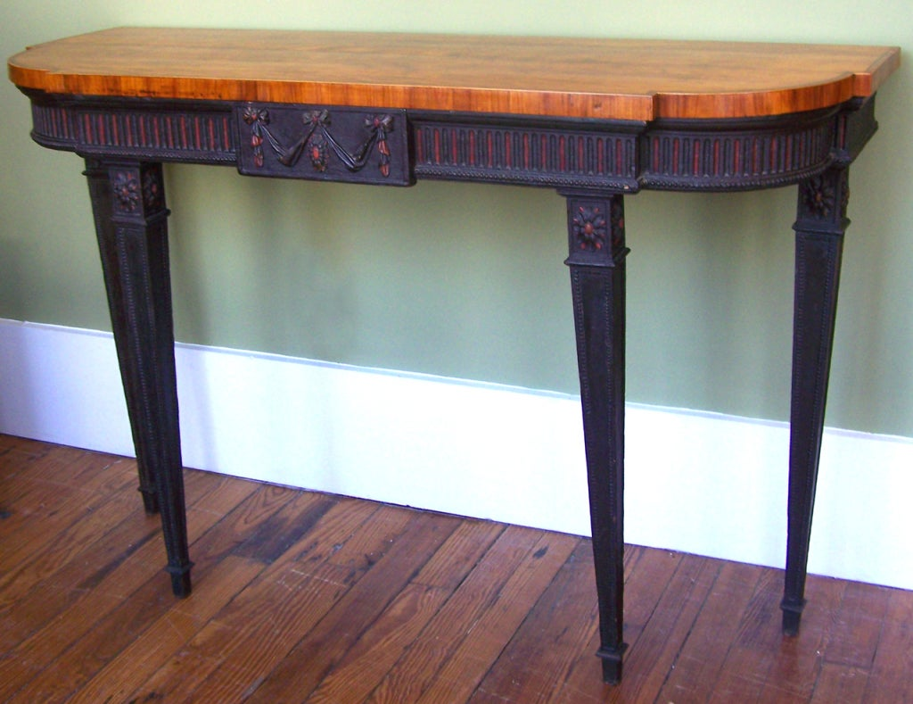 A beautiful Adams console table with a tulip top and a elegantly painted and carved satinwood stand.