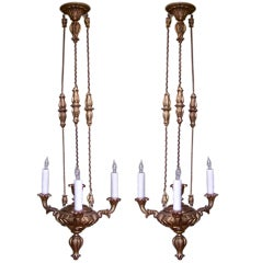 Pair of Carved Wooden and Gilt Chandeliers