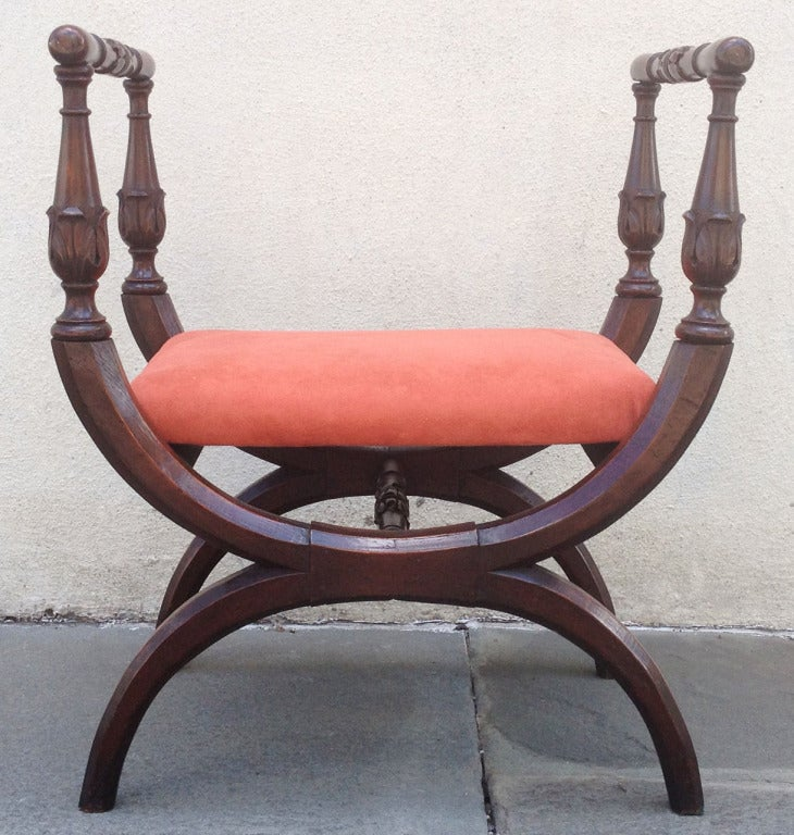 "A lovely hand-carved Italian walnut bench, circa 1815, with curulean frame and new rose colored suede upholstery. A related example can be found on page 315 of book called ""Italian Empire Furniture"" by Enrico Colle."