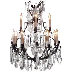 French Bronze and Crystal Two Tiered Chandelier.  Circa 1830