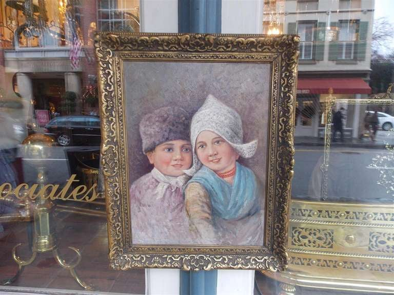 Dutch oil on canvas of boy and girl in gilt frame.  19th Century