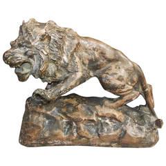 French Terracotta Lion on Rocky Plinth.  Circa 1880