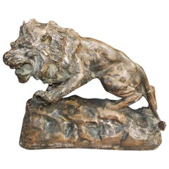 French Terracotta Lion on Rocky Plinth.  Circa 1880