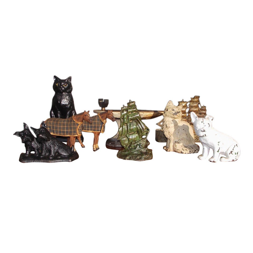 Grouping of Cast Iron Hand Painted Door Stops. Circa 1890