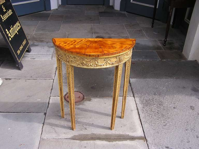 English Gilt Satinwood Demi-lune Console with pie shaped top and floral motif.  Dealers please call for trade price.