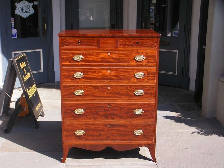 American mahogany two over five graduated drawer chest with Satinwood string inlay, carved scalloped skirt, terminating on original splayed feet.  Late 18th Century