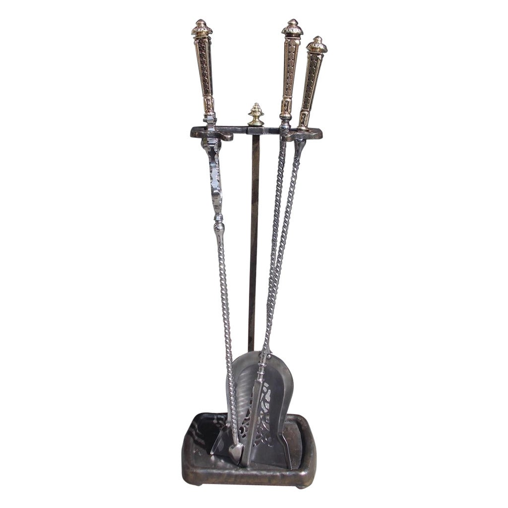 Set of irish polished steel and brass fire tools on stand
