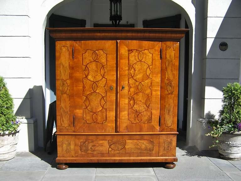 Austrian Biedermeier Burl Walnut & Mahogany cask with carved molded edge cornice, flanking book matched hinged doors, tulip wood inlays, satinwood inlays, original steel engraved locks & hinges , secret hinged till,  and terminating on a carved