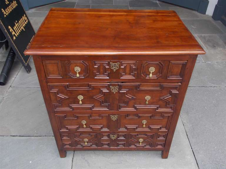 Englishred cedar and cherry top four drawer chest with geometrical motif, original drop pull brass hardware terminating on block feet.  Oak and Spanish cedar secondary woods.  Signed Lane Poot, 1700.
