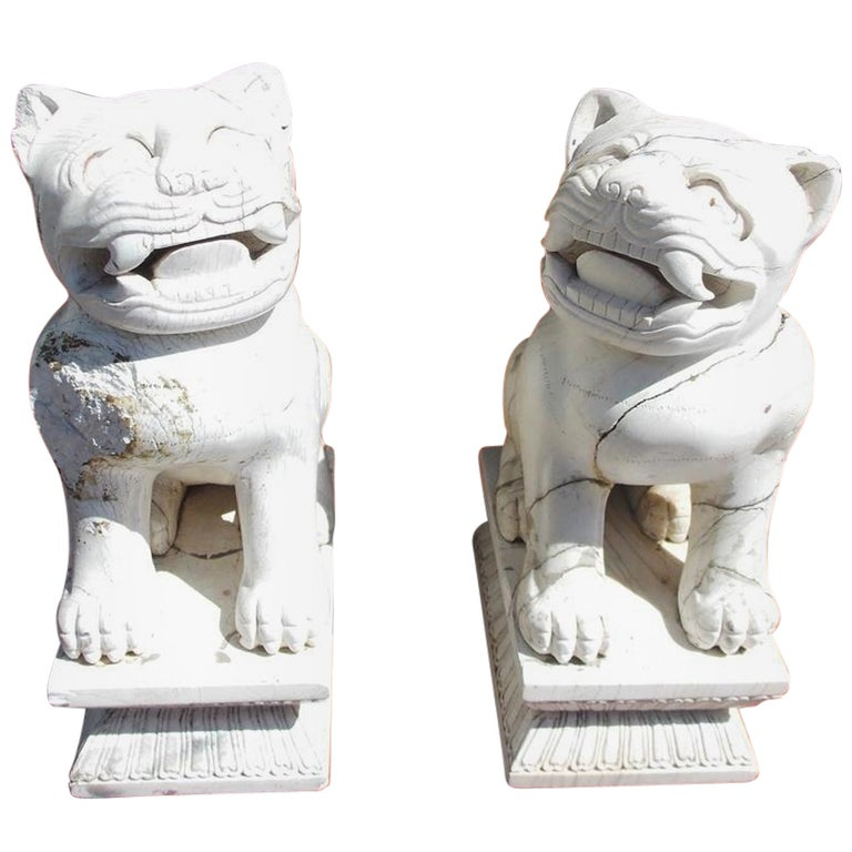 Pair of Chinese Stone Foo Dogs. Circa 1850 For Sale