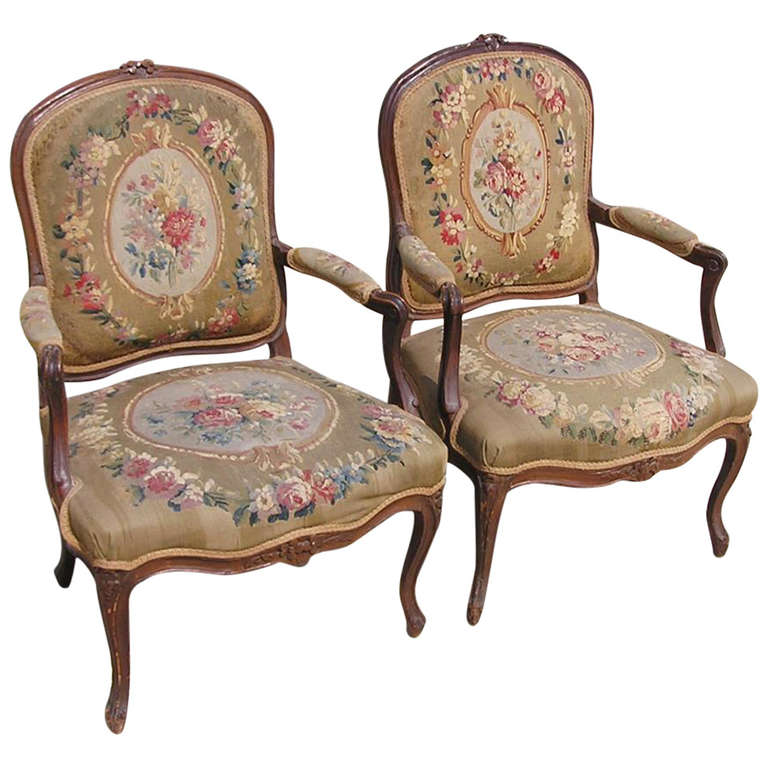 Pair of French Louis XVI Walnut Armchairs, Circa 1770