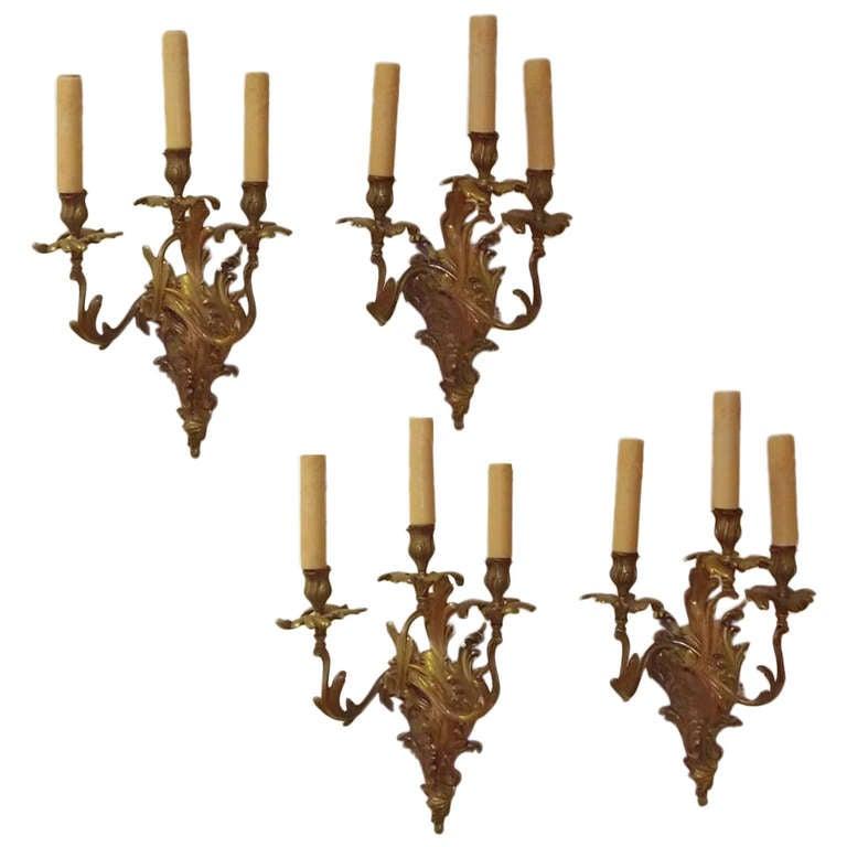 Set of Four French Gilt Bronze Three Arm Sconces, Circa 1820