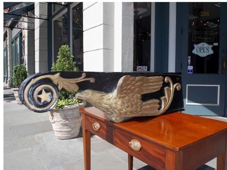American nautical carved wood, painted, and gilt eagle bow figurehead with scrolled and star motif.  Dealers please call for trade price.
