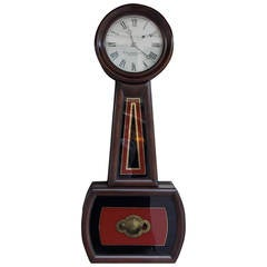 American Mahogany and Églomisé Banjo Clock,  E. Howard, Boston, Circa 1860