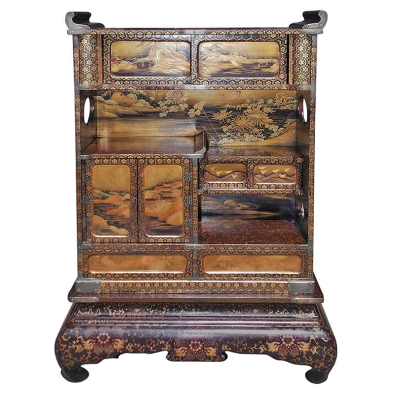 Japanese Lacquered and Stenciled Cabinet on Stand. Circa 1840