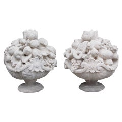 Pair of Italian Hand Carved Sandstone Fruit Baskets on Plinths. Circa 1830