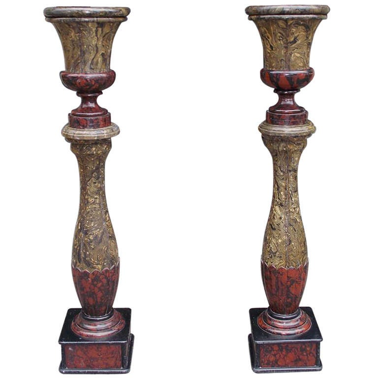 Pair of English Faux Painted Campaign Urns on Bulbous Columns