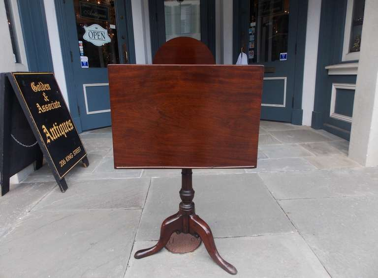 English mahogany tilt top podium with turned bulbous pedestal terminating on carved knee with slipper feet.  Late 18th Century