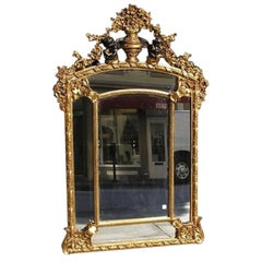 French Carved Wood & Gilt Cherub Acanthus Wall Mirror. Circa 1820.