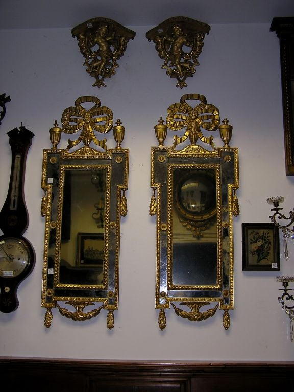 Neoclassical Pair of Italian Gilt Carved Floral Wall Mirrors. Circa 1780 For Sale