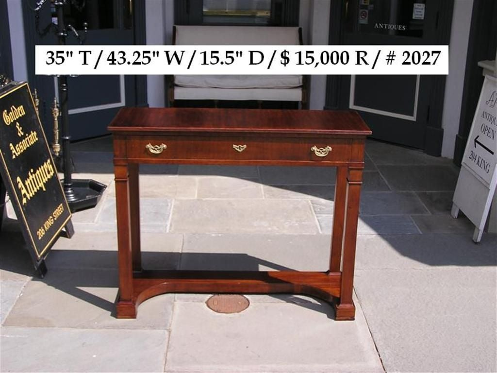 English mahogany one drawer diminutive console with carved molded edge,  original brass pulls, lower horizontal base, and terminating on Marlboro feet. Early 19th Century