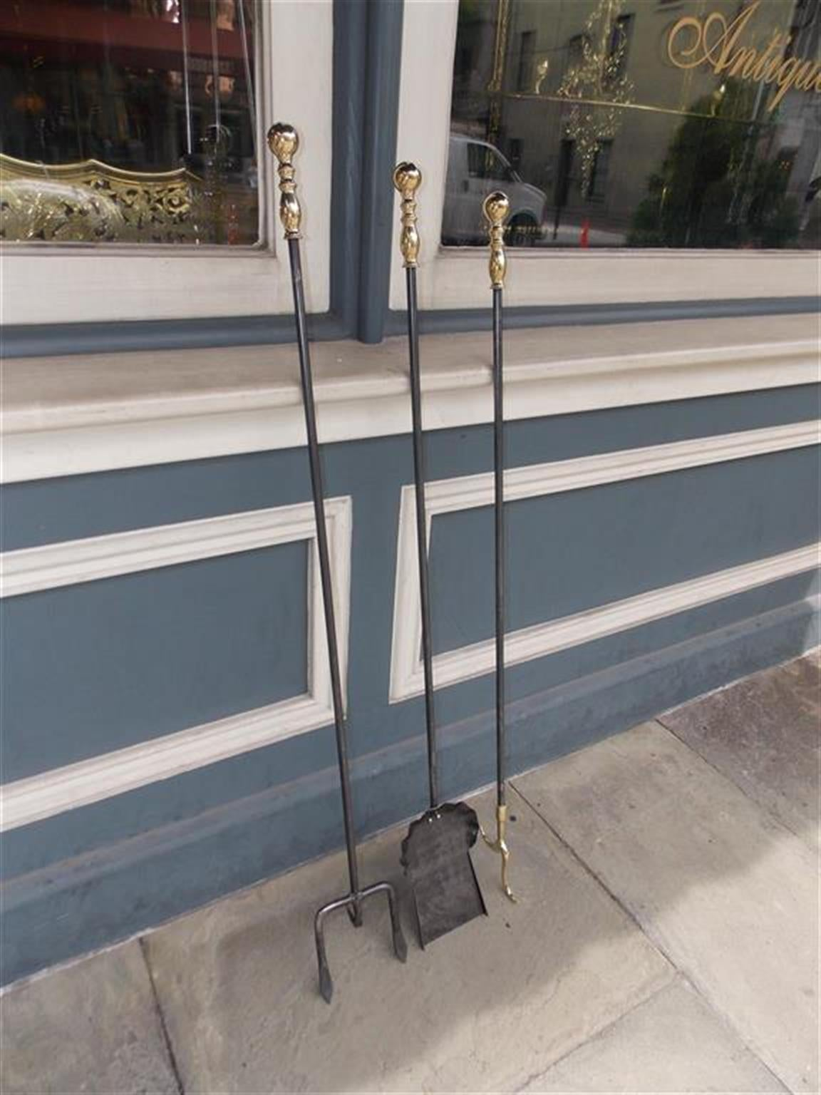 Set of American monumental wrought iron and brass fire tools with turned bulbous finial handles. Set consist of shovel, poker, and fork, 19th century.