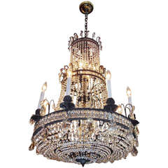 French Bronze and Crystal Three-Tiered Chandelier. Circa 1820
