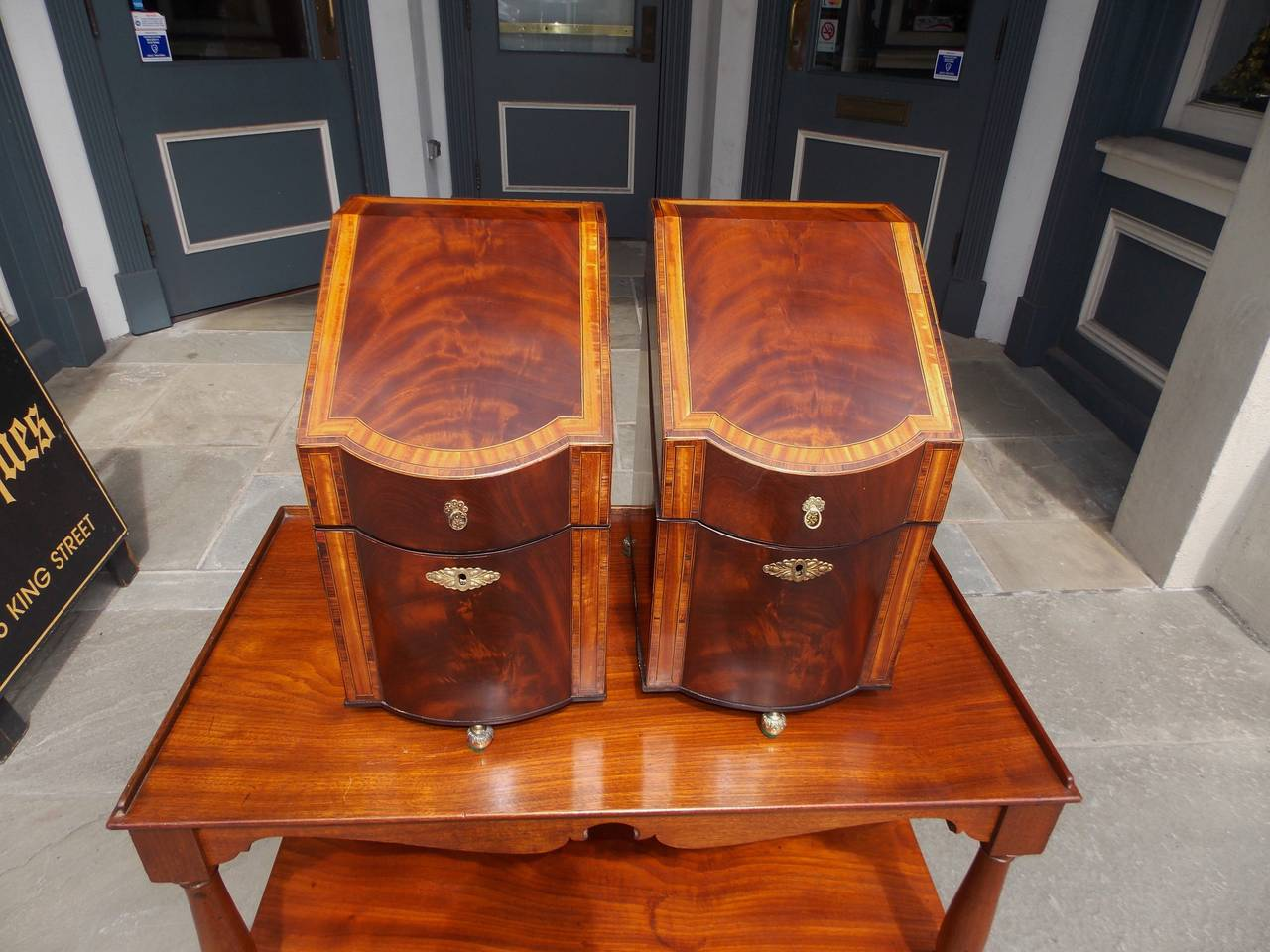 Pair of American mahogany cutlery boxes with inlaid satinwood banding, tulip wood cross banding, original ormolu mounts & fitted interior, diamond string inlay, and terminating on original brass floral ball feet. The interior is Spanish Cedra and
