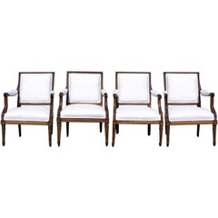 Set of Four French Gilt Arm Chairs