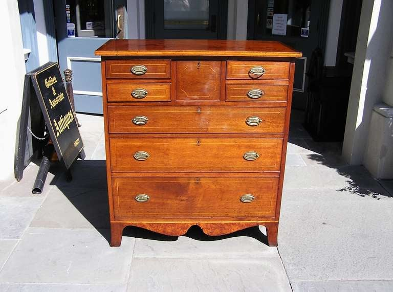 American Walnut graduated chest of drawers with box wood string inlay, burl walnut carved skirt, and terminating on original splayed feet.  Dealers please call for trade price.