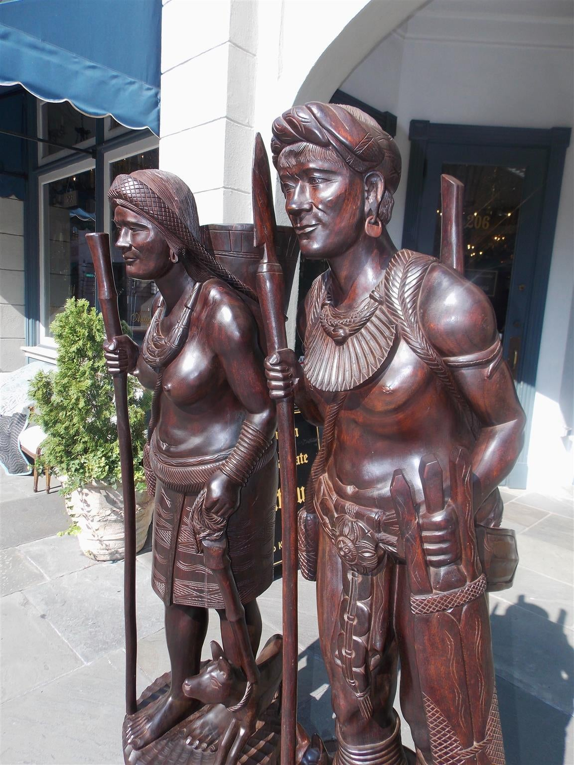 Anglo-Indian Pair of Igorot Tribesmen Figural Hunter and Huntress Carvings, Circa 1900 For Sale