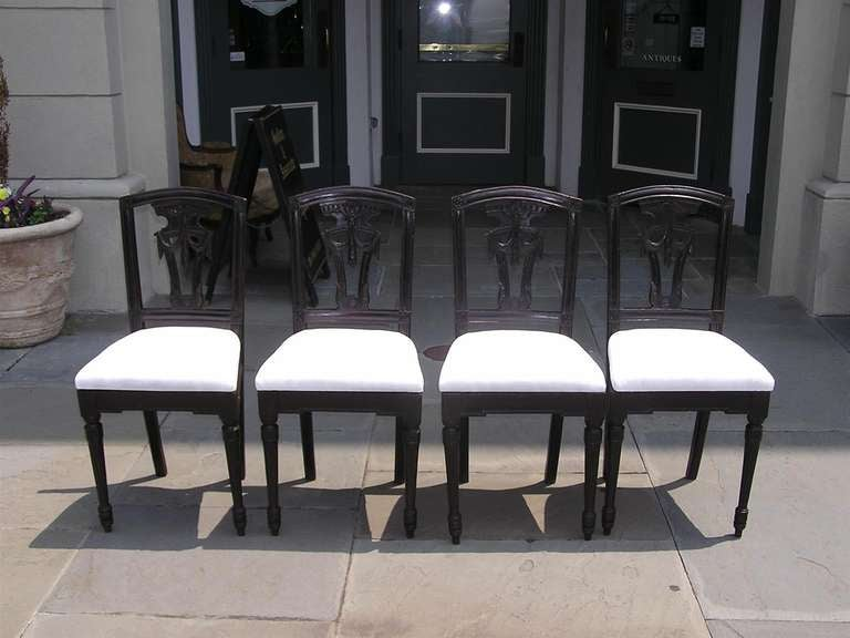 Set of four Italian mahogany side chairs with carved floral corner medallions, splat back with acanthus floral swags, and terminating on fluted bulbous legs.  Chairs are upholstered in white Muslin.  Dealers please call for best price.