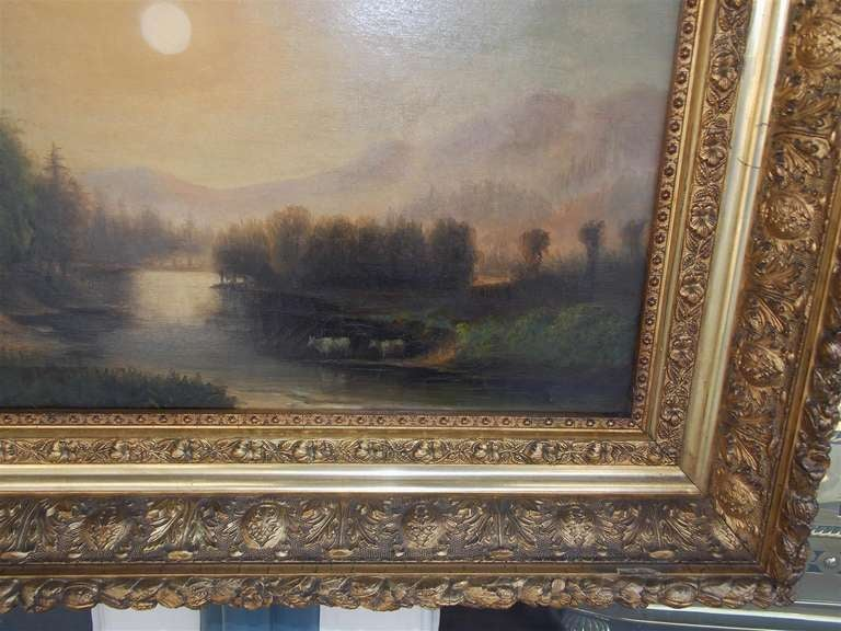 American oil on canvas landscape  with watering cows in original gilt carved floral frame.  Dealers please call for trade price.