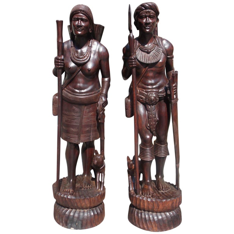 Pair of Igorot Tribesmen Figural Hunter and Huntress Carvings, Circa 1900 For Sale