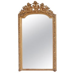 French Gilt Carved Wood Floral and Cherub Wall Mirror.  Circa 1790