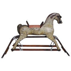 American Carved Wood & Faux Painted Rocking Horse.  Circa 1890