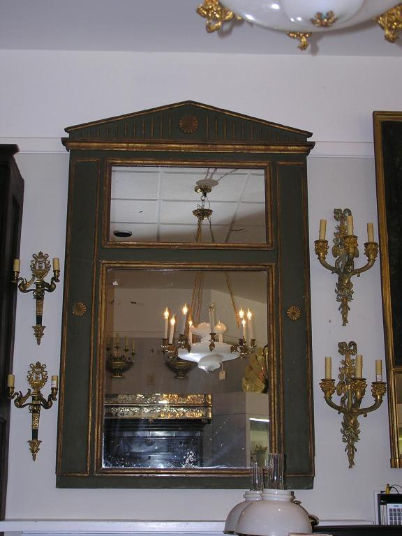 French painted and gilt trumeau mirror with palladian top, carved gouge work, and floral medallion motif. All original.