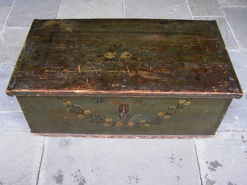 American Pine hand painted blanket chest with original interior till, wrought iron hinges, lock with key, and painted floral swag motif. Dated C. 1819