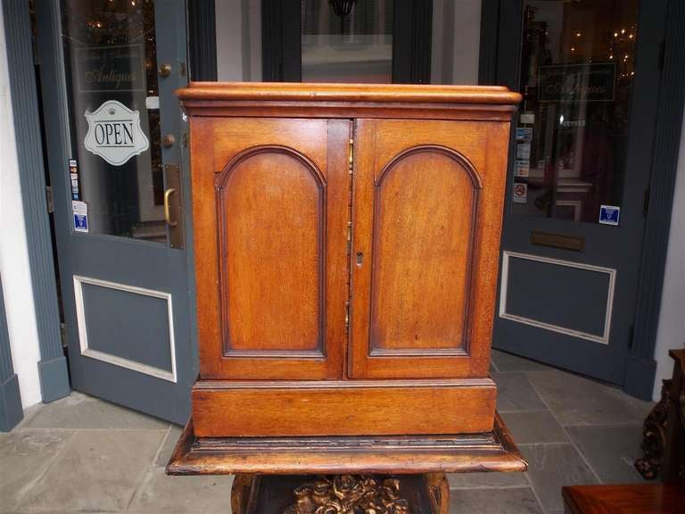 English mahogany two door campaign medical box opening to reveal three drawers with original recessed brasses.  Circa 1830
