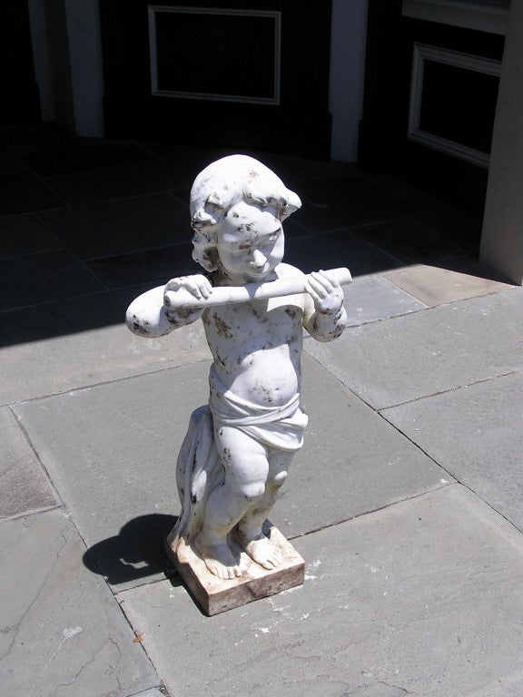 French marble statue of Pan playing flute while resting on garden stool and terminating on squared base.