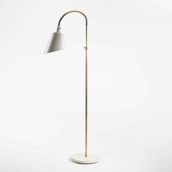 Early (and becoming quite rare) adjustable floor/reading lamp designed by Arne Jacobsen (Denmark, circa 1929) for Louis Poulsen in white enameled metal with brass stem. In excellent working order. Literature: Arne Jacobsen, Thau and Vindum, pg. 11.