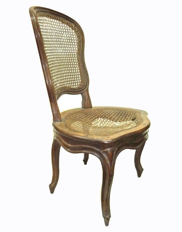 Set of four louis xv walnut chaises a la reine pierre for Chaises louis xv cannees