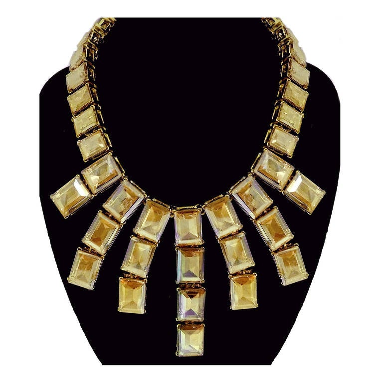 """I fell in love with this necklace the minute I saw it. Anyone will look great in it. This Kenneth J. Lane necklace features citrine color crystals in a gold-tone setting. This necklace measures 18"""" with a hook closure and a front drop of 3 3/8""""."""