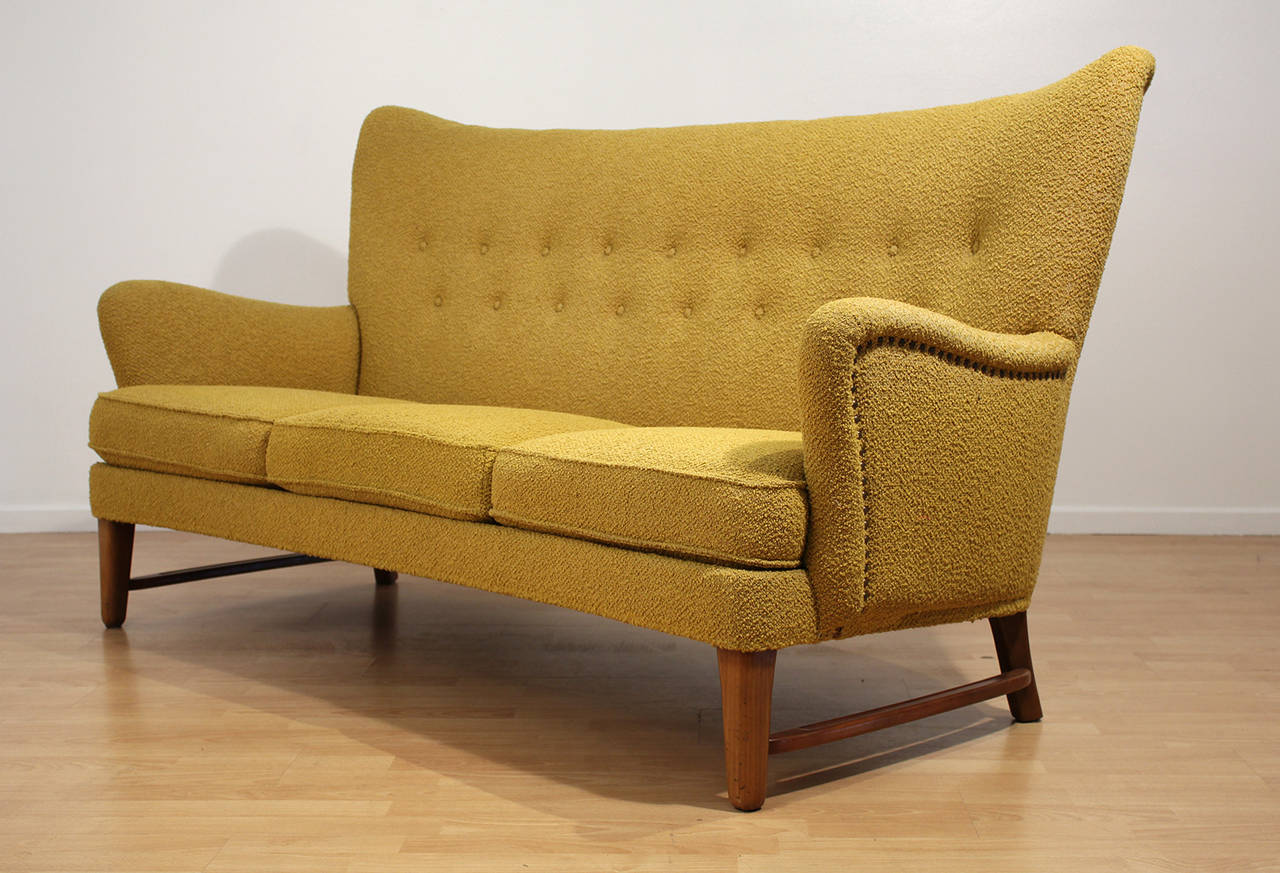 An Exceptional Early Modernist Wing Back Sofa Matching Chairs Also Available This Entire Set