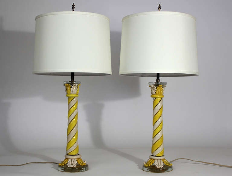 Pair of unusual and early Murano table lamps with twisted pillar columns of ivory and yellow colored glass, original finials and double bulb clusters. Excellent original condition.  5.5