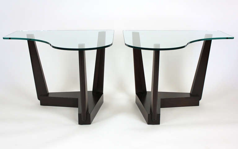 Pair of end tables custom designed in 1951 for the Johnston estate in Southern California. Dark lacquered finish with piano shaped glass tops.  Measurements are for each piece.