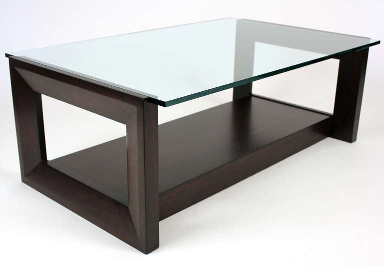 Low rectangular cocktail or occasional table custom designed in 1951 for the Johnston estate in Southern California. Dark lacquered finish glass top.