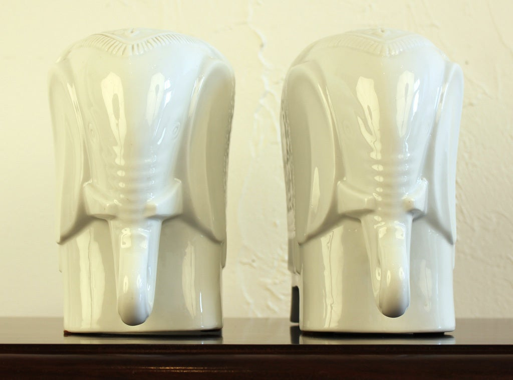 Pair of Chinese blanc de chine porcelain elephant bookends designed by Maitland-Smith. Retains original labels as pictured. Measurements are for each piece.